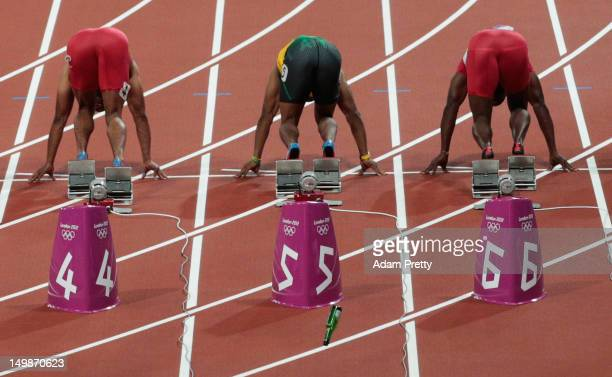 A bottle is thrown onto the track as runner get for the Men's 100m Final on Day 9 of the London 2012 Olympic Games at the Olympic Stadium on August 5...