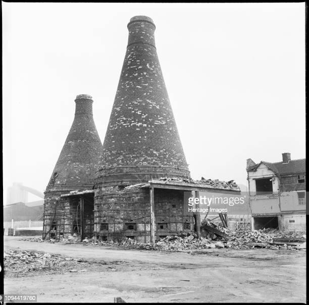 Bottle kilns, Etruria Pottery Works, Stoke-on-Trent, Staffordshire, 1965-1968. Two bottle kilns standing amidst the debris of the Josiah Wedgwood's...