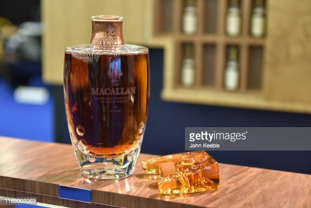 Bottle of 55 years old Macallan highland single malt scotch whisky in Lalique is displayed during the RM Sotherb's London, European car collectors...