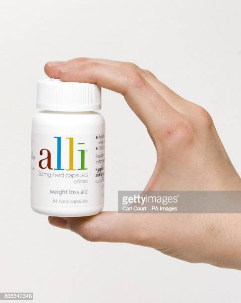 A bottle of Alli capsules a new clinically proven overthecounter weight loss aid produced by GlaxoSmithKline goes on sale in pharmacies throughout...