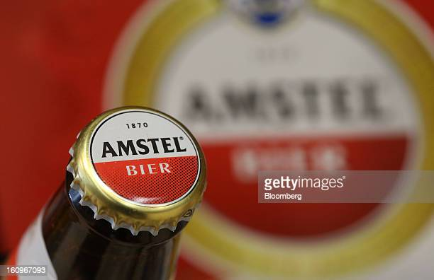 A bottle of Amstel lager beer produced by Heineken NV sits on display inside a supermarket in London UK on Friday Feb 8 2013 Britain's economy will...