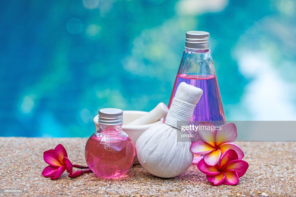 bottle of aroma essential oil or spa and natural fragrance oil with dry flower