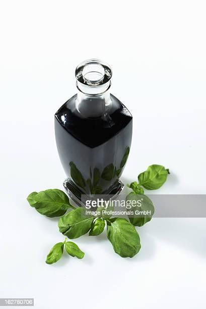 Bottle of balsamic vinegar with fresh basil