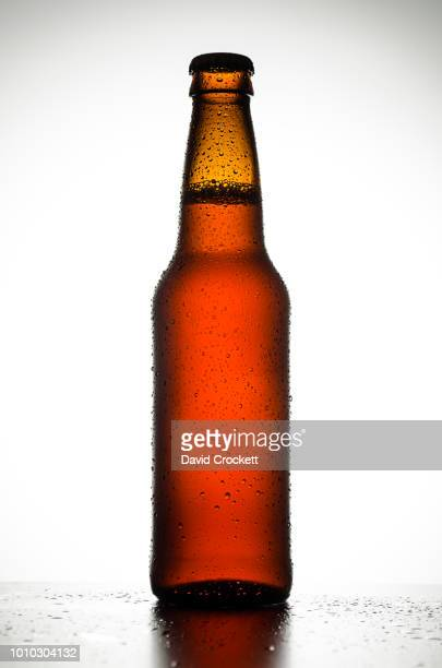bottle of beer with condensation - beer bottle stock pictures, royalty-free photos & images