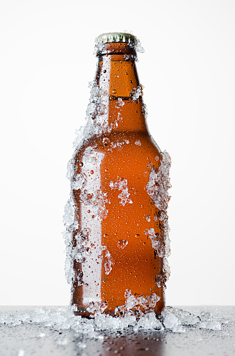 Bottle of beer with frosted ice - gettyimageskorea