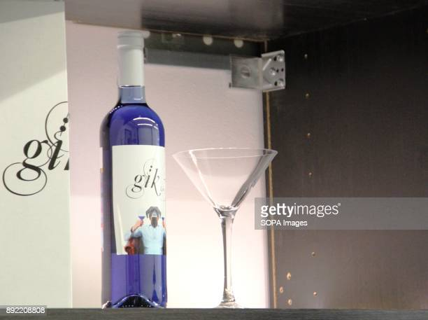A bottle of blue wine seen next to a glass Gik Blue Wine is the first Blue wine in the world is Produced in Bilbao Spain Gik Blue combines red and...