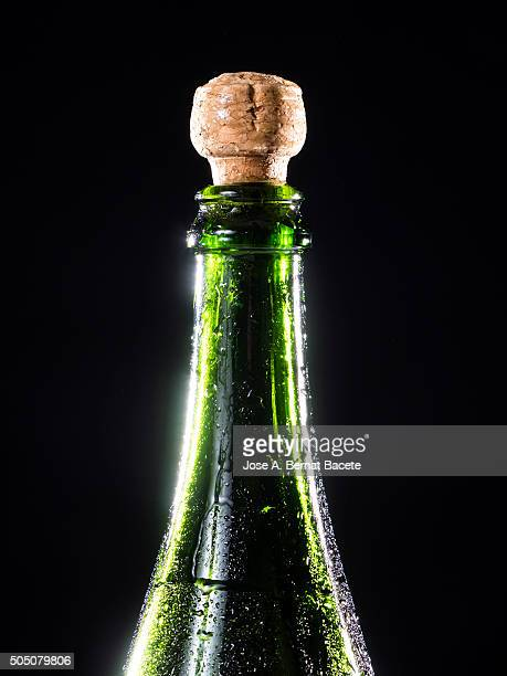 Bottle of cava or champagne on a surface with water droplets