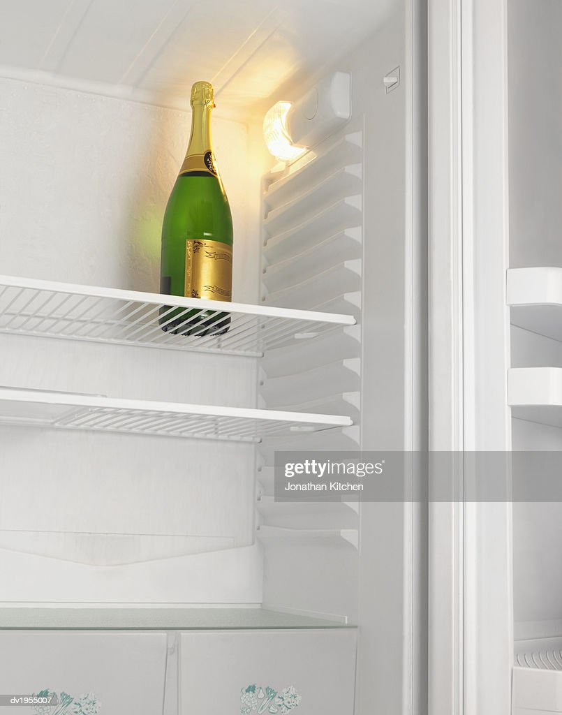 Bottle of Champagne in a Fridge : Stock Photo