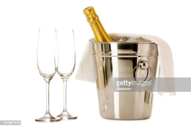 Bottle of Champagne in cooler with two glasses