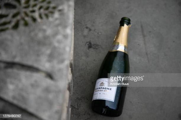 Bottle of Champagne lies discarded on 5th of November 2020, City of London, United Kingdom. It is the first day of national lockdown and many people...