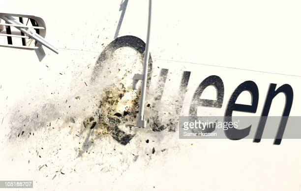 A bottle of champagne smashes to officially name Cunard's new cruiseliner Queen Elizabeth II in Southampton Docks on October 11 2010 in Southampton...