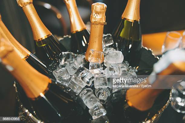 bottle of champagnes in ice bucket - champagne stock pictures, royalty-free photos & images