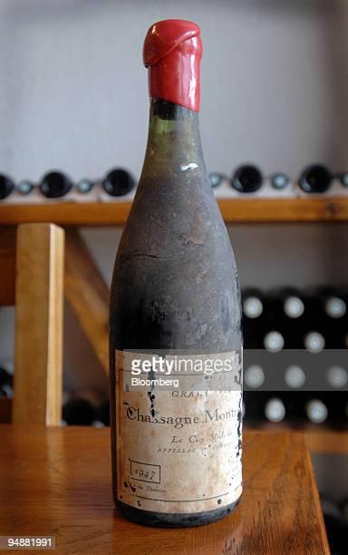 Bottle of Chassagne-Montrachet Clos Saint Jean sits on a table at the los Saint Jean vineyard, in the Burgundy village of Chassagne-Montrachet,...