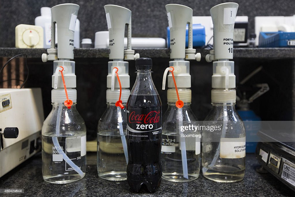 A bottle of Coke Zero stands in the quality control laboratory ahead of testing at the Lanitis Bros Ltd. bottling plant, part of the Coca-Cola Hellenic Group, in Nicosia, Cyprus, on Tuesday, June 10, 2014. Zug, Switzerland-based Coca-Cola Hellenic Bottling Co., which distributes Coca-Cola products in countries including Russia, wants to move away from using imported sugar for its Russian operations by 2015. Photographer: Andrew Caballero-Reynolds/Bloomberg via Getty Images