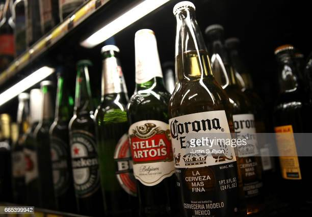 A bottle of Corona beer is displayed on the a shelf at a supermarket on April 6 2017 in San Rafael California Constellation Brands maker of popular...