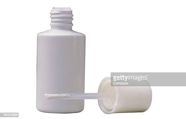 bottle of correction fluid - correction fluid stock pictures, royalty-free photos & images