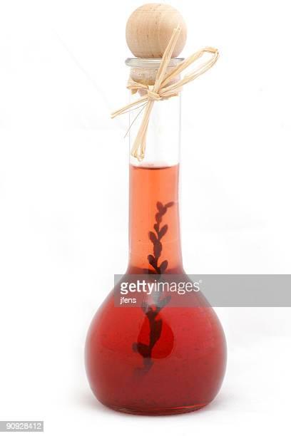 Bottle of cranberry vinegar - white background