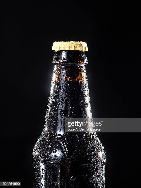 Bottle of crystal of cold beer with water drops