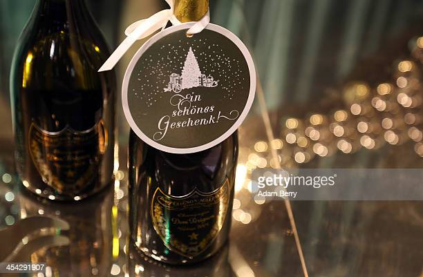 A bottle of Dom Perignon champagne with the words 'A Beautiful Gift' in German is seen in the window of a department store on December 8 2013 in...