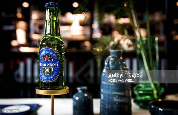 A bottle of Dutch brewing giant Heineken's first alcoholfree beer called Heineken 00 is pictured on March 3 2017 i Amsterdam / AFP PHOTO / ANP / Koen...