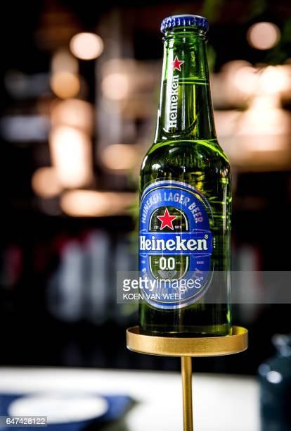 A bottle of Dutch brewing giant Heineken's first alcoholfree beer called Heineken 00 is pictured on March 3 2017 i Amsterdam / AFP PHOTO / ANP / Koen...