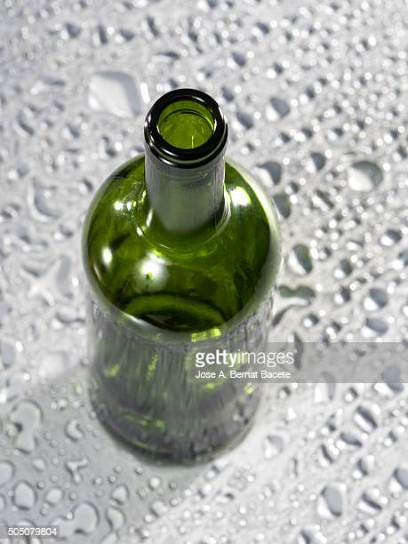 Bottle of empty vine on a wet surface