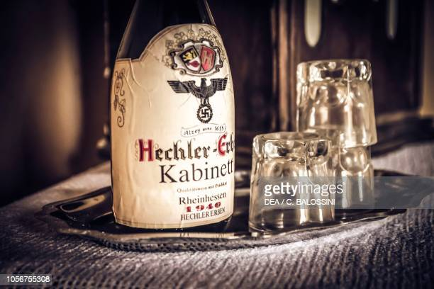 Bottle of German wine and glasses on a tray in the commander's office Edelweiss DRK Section Lazarett Normandy France 1944 World War II 20th century...