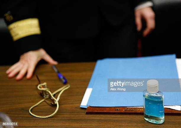 A bottle of hand sanitizer s2its on the table in front of Interim Deputy Director of Science and Public Health Program Rear Admiral Anne Schuchat of...
