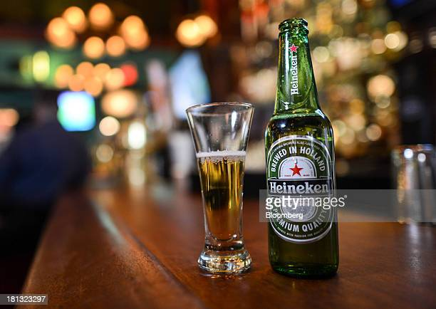 A bottle of Heineken beer produced by Heineken NV is arranged for a photograph in Ridgewood New Jersey US on Wednesday Sept 18 2013 Heineken NV the...