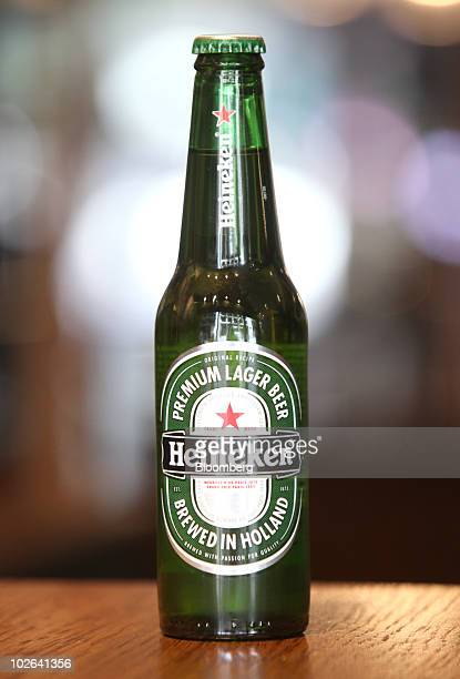A bottle of Heineken beer produced by Heineken NV sits arranged for a photograph in London UK on Tuesday July 6 2010 Punch Taverns Plc the largest UK...