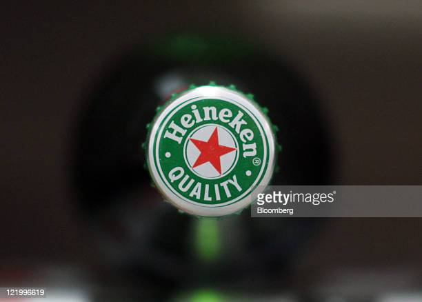 A bottle of Heineken lager beer produced by Heineken NV sits on display at a supermarket in London UK on Wednesday Aug 24 2011 Heineken NV the...