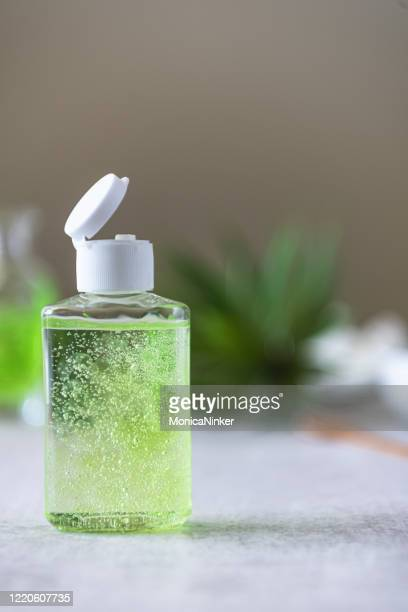 bottle of homemade hand sanitizer in bottles and ingredients - home made stock pictures, royalty-free photos & images