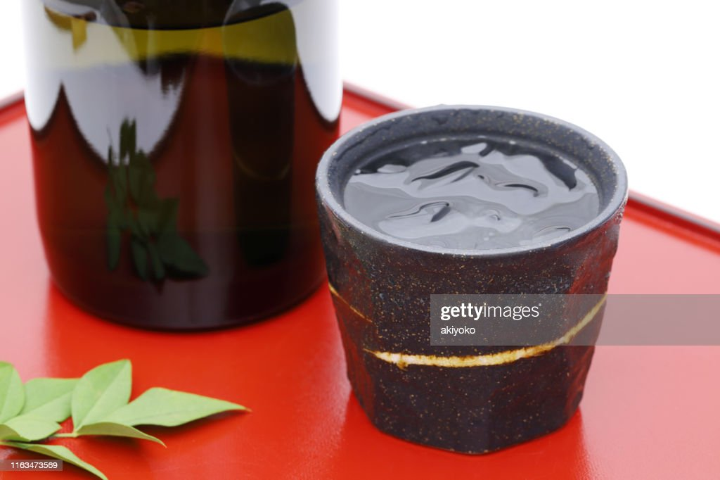 Bottle of Japanese shochu and ceramic bowl : Stock Photo