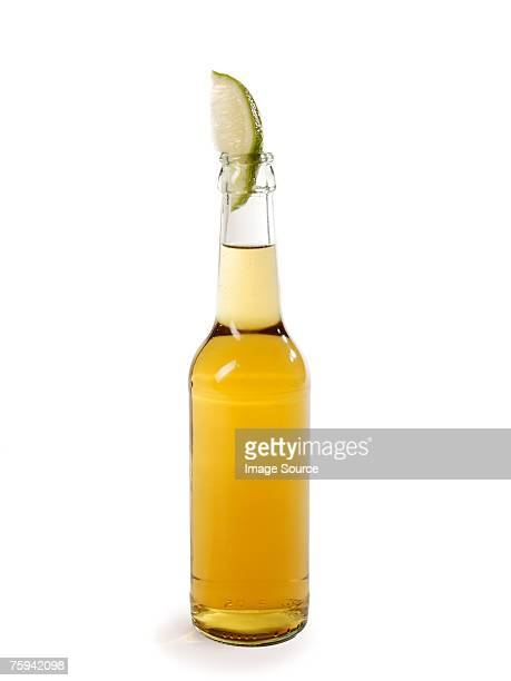 Bottle of lager and slice of lime