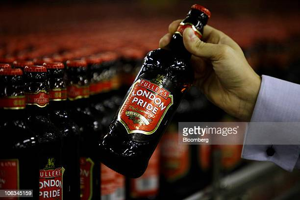 A bottle of London Pride ale is removed from a conveyor belt at the Fuller Smith Turner Plc brewery in London UK on Friday Oct 29 2010 Fuller's brews...