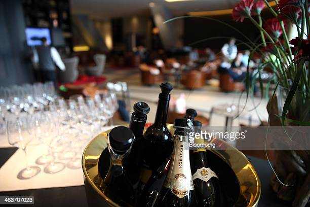 A bottle of Louis Roederer champagne sits in a ice bucket at the 'Nuts Co' bar at the InterContinental hotel Davos operated by InterContinental...