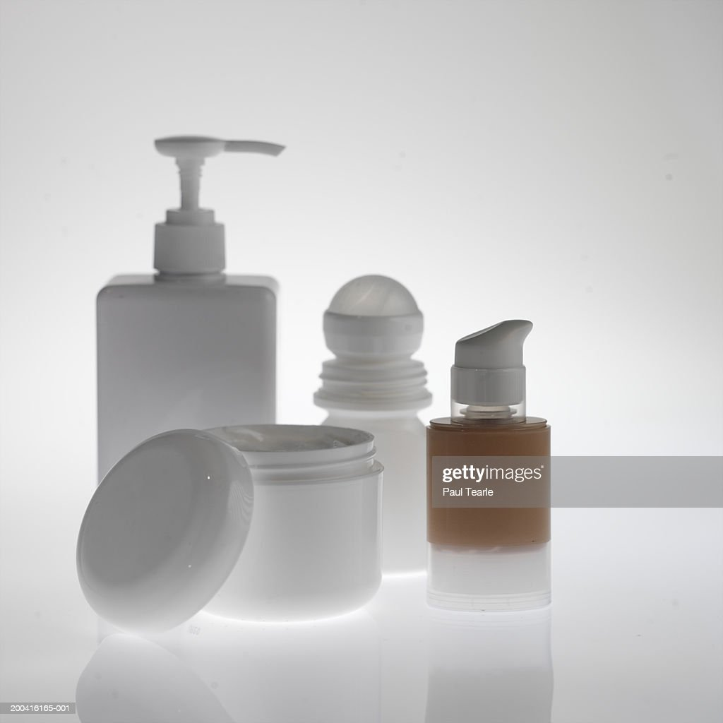 Bottle of make-up, deodorant, soap dispenser, moisturiser tub close up : Stock Photo