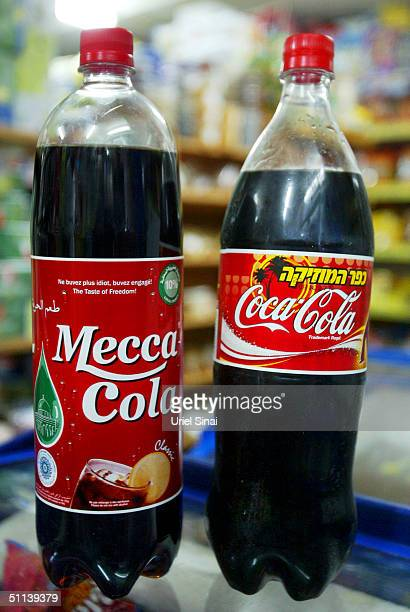 A bottle of MeccaCola sits next to a bottle of CocaCola at a grocery store August 3 2004 in the Israeli Arab town of Taibeh Israel Beginning this...