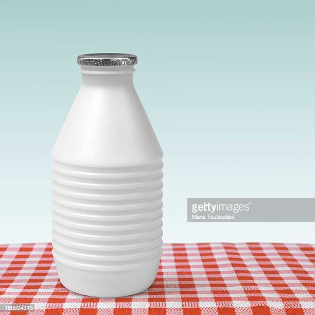 Bottle of milk on checkered tablecloth