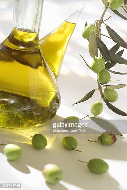 bottle of olive oil - cruet stock photos and pictures