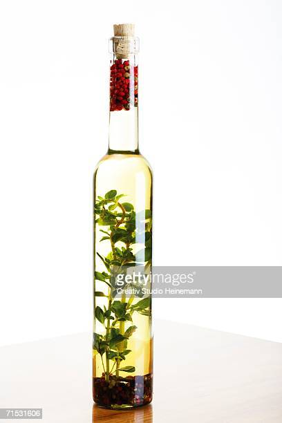 bottle of olive oil with herbs and spices, close-up - cork material stock photos and pictures