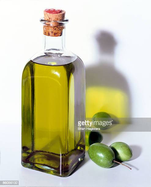 bottle of olive oil with olives - olive oil stock pictures, royalty-free photos & images
