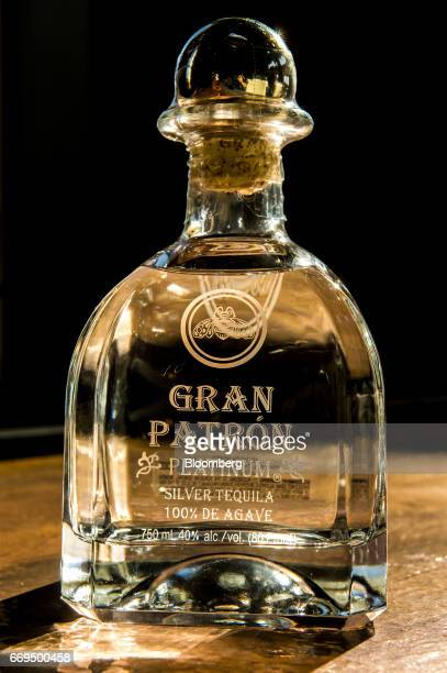 A bottle of Patron Spirits Co brand Platinum Silver Tequila is arranged for a photograph at the company's distillery in Atotonilco El Alto Jalisco...