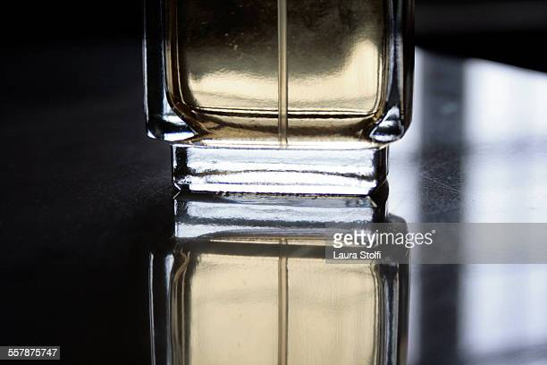 Bottle of perfume and its reflection