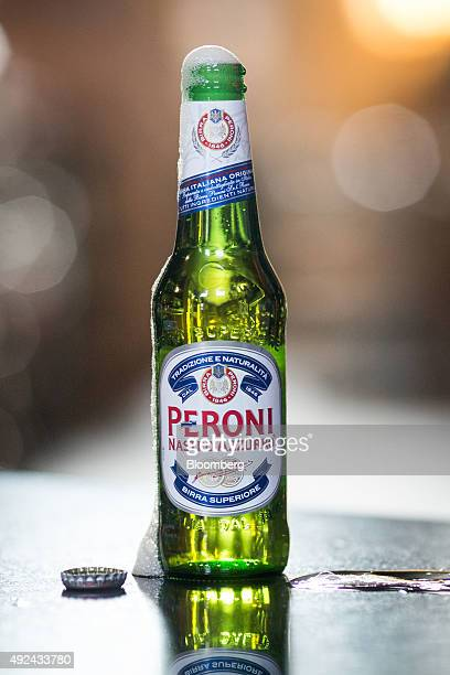 A bottle of Peroni beer brewed by SABMiller Plc stands in The Capitol a JD Wetherspoons Plc public house in this arranged photograph in London UK on...