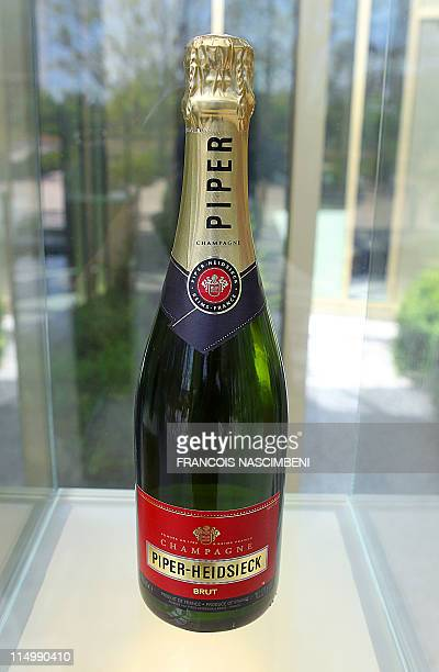 Bottle of Piper-Heidsieck champagne is displayed in the headquarters of the Remy Cointreau company, near the French northeastern city of Reims, on...
