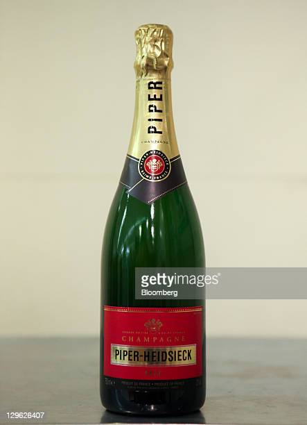 Bottle of Piper-Heidsieck champagne, produced by Remy Cointreau SA, are arranged for a photograph in London, U.K., on Tuesday, Oct. 18, 2011. U.K....