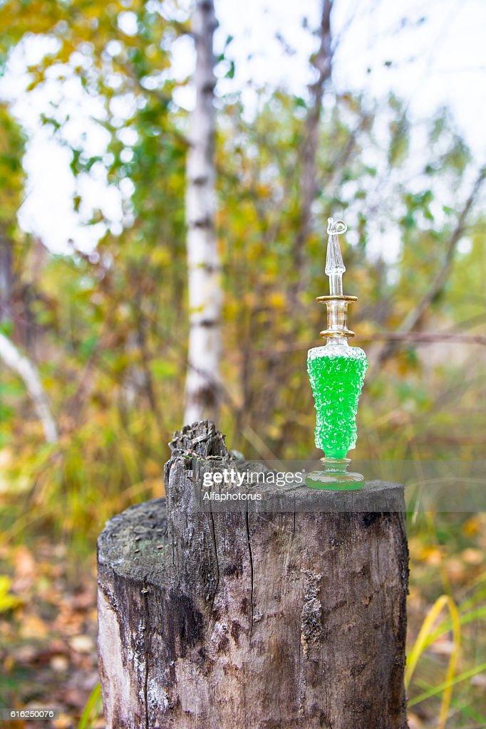bottle of poison, poisonous capsule, halloween : Stock Photo