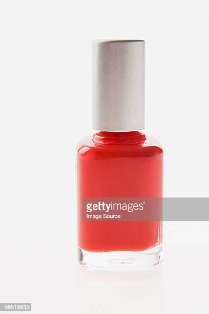 bottle of red nail varnish - nail polish stock pictures, royalty-free photos & images