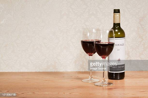 Bottle of red wine and wine glasses